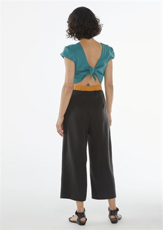 """Picture of """"knot"""" jumpsuit in teal-orange- black"""