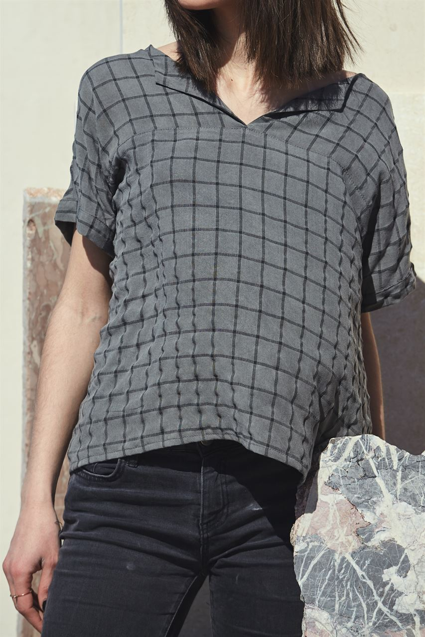 Picture of slit top in checked grey